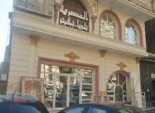 محل تجاري دورين و بدروم للبيع في ترسا - الهرم