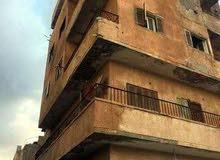 عمارة في اخريبيش على شارعين خمس طوابق الطابق الأول محلات و اربع شقق السعر 300الف