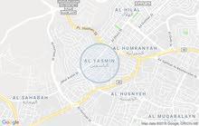 أرض مميزة جداُ للبيع مساحة 979م/ ضاحية الياسمين 1