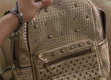 girls golden backpack