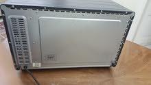 Used refrigerator .. working fine . ثلاجه سانيو مستخدمه مع فرن  للبيع