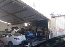 محل بدي و دهان سيارات في المنطقه الحره للبيع