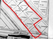 للبيع قطعة ارض مبني عليها 6 محلات وشبره