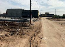 قطعة أرض مساحتها 200 متر بشارع اللواء بالتنومة قريبه من الجسر الجديد