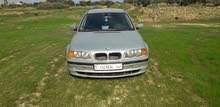 BMW 318 car for sale 1999 in Al-Khums city