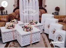للايجار دزه عروس بحالة جيدة جداً  اربع شنط واربع صناديق كبار و7 أكياس ملابس مع الستاند الابيض