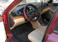 Maroon Hyundai Sonata 2009 for sale