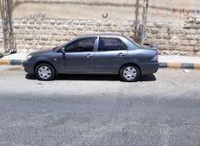 ميتسوبيشي لانسر 2012 بحاله ممتازه للبيع او البدل ع سياره بقيمه 2.500