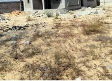 منزل وقطعة أرض للبيع