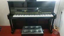 بيانو خشبي كاواي kawai صناعه يابانية مع الكرسي الاصلي سعره جديد 2000 دينار