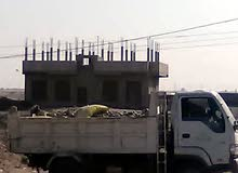 عمارة على الشارع الرئيسي بعد نقطة الرباط دور وعمدان ب60 مليون يمني عررطه