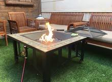 طاولة مشب تعمل بالغاز والحطب للشوي والتدفئة جديدة