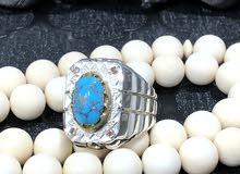 خاتم فيروز نيشابوري بصياغة جراح مرصع بعدد 4 حبات الماس