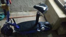 دراجة سكوتر الشحن معها و المفتاح معها