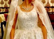 فستان عرس مستعمل ..كامل الاغراض ..بسعر 250 دينار