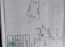 قطعة أرض سكنية مساحتها 427.98 في منطقة جامع فطره بعد مثلت الكهرباء علي اليمين