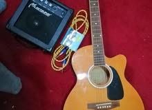 اكوستك جيتار مع مكبر صوت