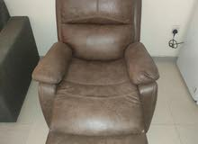 كرسي جلد يفرد سرير بالكامل