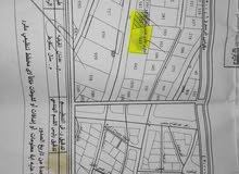 قضطعتين ارض للبيع بعر مغري بمنطقه مميزه ع شارع الرئيسي