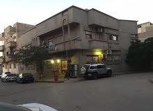 منزل مع مبنى خلف مصرف الواحه ومصحه الليبي الالماني