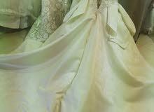فستان زفاف جوميه جديد للبيع وارد الخارج لونه شامبين