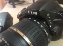 nikon D5100 with tamron lens (18-200)