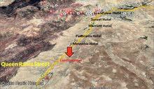 ارض سياحي قريبة من الفنادق في البتراء / وادي موسى  للبيع