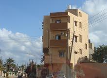 عمارة سكنية تجارية للبيع مكونة من اربع طوابق وداخل المخطط
