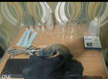 إدوات و معدات زجاجية و مواسك و جوانتيات المعامل الكيميائية