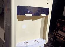 Water dispenser with small refrigerator