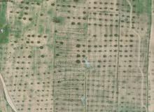 قطعة ارض للبيع ترهونه مقابل السرخانه الرئيسيه طريق العبد للجادين فقط 0922511559