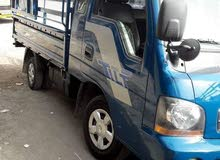 Manual Blue Kia 2001 for rent