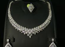 اطقم تصميم الماس مطلي بالذهب ومرصع بالزركون