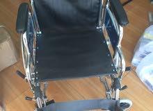 كرسي للمقعدين (متحرك)جلد