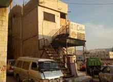 محل تجاري  طابقين على شارع رئيس