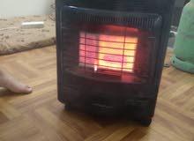 صوبه غاز ثلاث شعلات مع دفايه كهرباء ثلاث شمعات