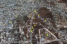 ارض للبيع مساحة دونم جنوب صالات السفير وغرب فيلا منور