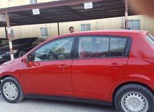 Nissan tida red color 2011 car for sale. Insurance valued till may 2020. Dubai Registered car.