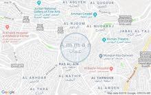 عمارة في الوحدات شارع النادي محلين + طابق ثاني بناء جديد