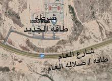 خلف مركز الشرطة على مخطط شارع 30 متر عرضي مزدوج واجهة جنوبية بحريه