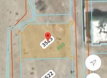 ارض سكنية شبه كورنر بالعامرات النهضة مربع 15