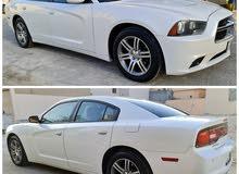 للبيع دوج جارجر 6 سلندر موديل 2013 اللون أبيض صدفي ماشي 100 شهر 4مسجل ومؤمنه سنه