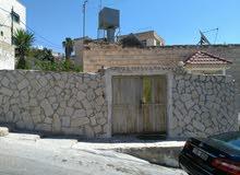 منزل طابقين  واجهتين حجر  للبيع  اسكان  الخندق السلط