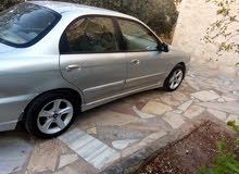 For sale a Used Kia  2003