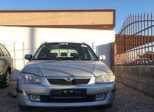 Mazda 323 car for sale 2000 in Al-Khums city