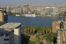 شقة 220 م ببرج جوهرة مكة بشارع مراد شارل ديجول -الجيزة تطل على النيل