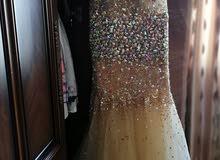 فستان ذهبي للبيع