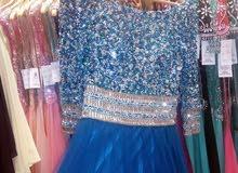 فستان ميريام فارس لون فيروزي