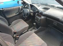 اوبل استرا تماتك ومش مكيفة اللون ابيض موديل 1997 ماشية 167كيف واصلة محرك 16في 16