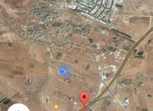 للبيع ارض 16 دونم في رجم الشامي على شارع الميه مباشره